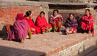 Nepal, Patan.  Women in Red, Talking.