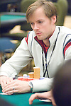 Dieter Dijkstra from London, reacts to seeing the cards on the table.