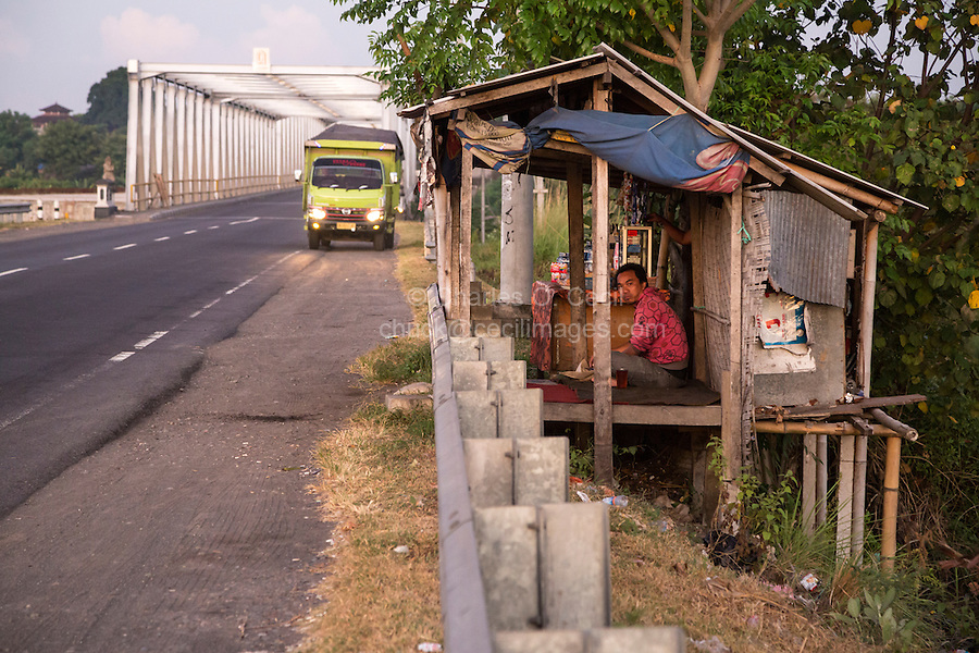 Bali, Indonesia.  Truck Driver at a Roadside Refreshment Stand, Early Morning.