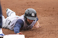 Colorado Springs Sky Sox outfielder Ben Guez (9) dives back to first during a Pacific Coast League game against the Iowa Cubs on May 11th, 2015 at Principal Park in Des Moines, Iowa.  Colorado Springs defeated Iowa 13-7.  (Brad Krause/Four Seam Images)