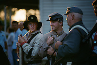 Muskets are fired after a prayer honoring a relative who was a Confederate soldier. <br /> Up to 1000 relatives gather at the homestead of the Tatum family for a reunion and three day celebration. On the first day, famly members arrive in costume and uniforms for a skit and reenactment of a skirmish.