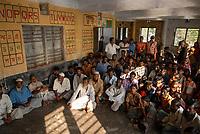 BANGLADESH, Khulna, village Kalabogi at river Shibsha close to the Bay of Bengal , people in flood protection bunker  / BANGLADESCH, Dorf Kalabogi am Fluss Shibsha , Schutzhaus fuer Dorfbewohner bei Flutkatastrophen und Wirbelstuermen