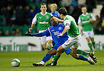 Hibs v St Johnstone....27.11.10  .Collin Samuel is tackled by Ian Murray.Picture by Graeme Hart..Copyright Perthshire Picture Agency.Tel: 01738 623350  Mobile: 07990 594431