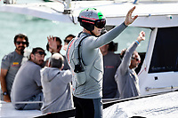 17th March 2021; Waitemata Harbour, Auckland, New Zealand;  Luna Rossa Prada Pirelli helmsman Jimmy Spithill waves to fans as they head out for Race 10. 36th America's Cup Race Village, Auckland Viaduct, New Zealand on Wednesday 17th March 2021.