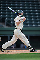 First baseman Ryan Krill (22) of the Michigan State Spartans bats in a game against the Harvard Crimson on Saturday, March 15, 2014, at Fluor Field at the West End in Greenville, South Carolina. Michigan State won, 4-0. (Tom Priddy/Four Seam Images)