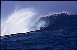 Teahupoo, Tahiti. May 2000. A surfer  gets tubed during the GOTCHA PRO 2000 at Teahupoo.