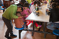 Blind and visually impaired Tibetan students have lunch at the canteen of the School for the Blind in Tibet, in the capital city of Lhasa, September 2016.