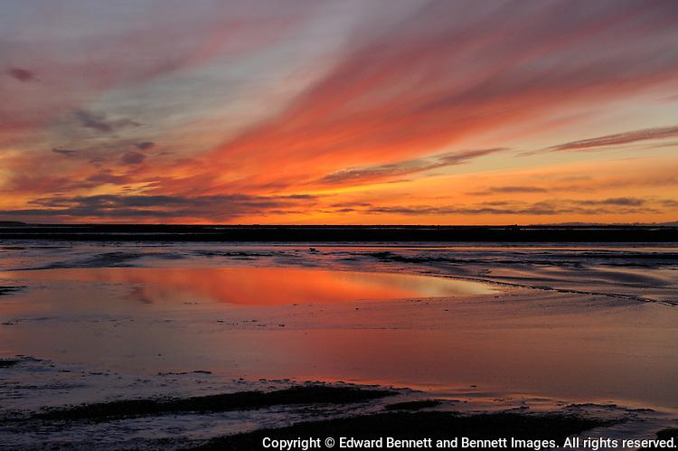 The sun sets over freezing ocean ice near Kaktovik, Alaska.