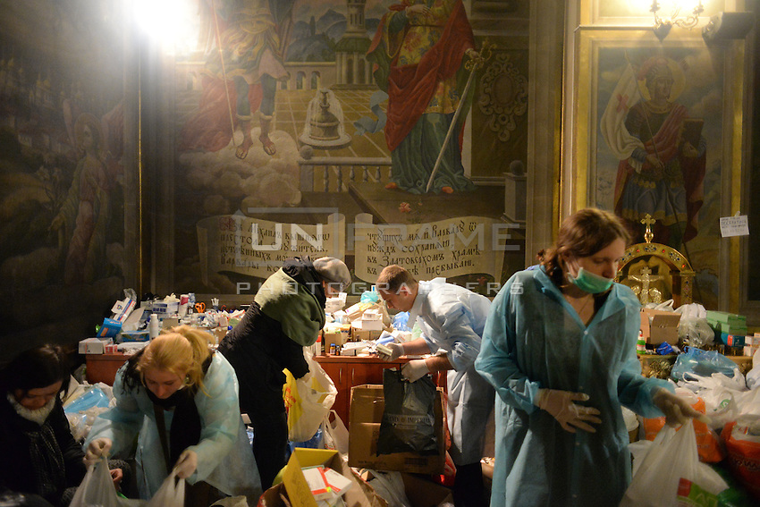 The inside of the Orthodox cathedral is turned into a makeshift clinic for treating the injured protesters.  Kiev, Ukraine