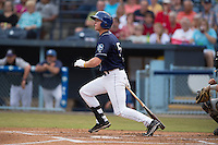 Asheville Tourists third baseman Ryan McMahon #5 swings at a pitch during a game against the Savannah Sand Gnats at McCormick Field July 17, 2014 in Asheville, North Carolina. The Tourists defeated the Sand Gnats 8-7. (Tony Farlow/Four Seam Images)