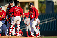 Palm Beach Cardinals manager Dann Bilardello (11) takes the ball from pitcher Griffin Roberts (32) during a pitching change as catcher Ivan Herrera (34) looks on during a Florida State League game against the Clearwater Threshers on August 10, 2019 at Roger Dean Chevrolet Stadium in Jupiter, Florida.  Clearwater defeated Palm Beach 11-4.  (Mike Janes/Four Seam Images)