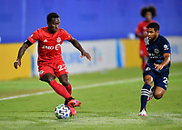 LAKE BUENA VISTA, FL - JULY 26: Richie Laryea of Toronto FC turns away from Ismael Tajouri-Shradi of New York City FC during a game between New York City FC and Toronto FC at ESPN Wide World of Sports on July 26, 2020 in Lake Buena Vista, Florida.