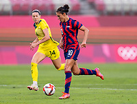 KASHIMA, JAPAN - AUGUST 5: Carli Lloyd #10 of the USWNT dribbles forward during a game between Australia and USWNT at Kashima Soccer Stadium on August 5, 2021 in Kashima, Japan.