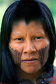 A-Ukre Village, Xingu, Brazil. A Kayapo woman with intricate black Genipapo face paint.   Payakan's wife.