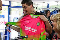 A fan looks at the new Away Golkeeper's top during the 2016/17 Kit Launch of Wycombe Wanderers to the public at Adams Park, High Wycombe, England on 10 July 2016. Photo by David Horn.
