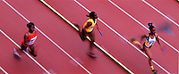 Overview of female runners at a track meet.