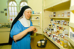 Sister Mary Eanfleda Barbara OSB at St Mary at the Cross convent, working in the ward of the old convent Care Home attached to Edgware Abbey  Middlesex UK 1989 1980s