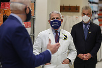 Dr. Anthony Fauci, director of the National Institute of Allergy and Infectious Diseases listens as President Joe Biden talks duding a visit to the Viral Pathogenesis Laboratory at the National Institutes of Health, on Thursday, February 11, 2021 in Bethesda, Maryland. <br /> CAP/MPI/RS<br /> ©RS/MPI/Capital Pictures