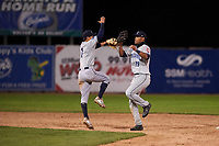 Lake County Captains Tyler Freeman (7) and Will Benson (29) celebrate a victory after a Midwest League game against the Beloit Snappers at Pohlman Field on May 6, 2019 in Beloit, Wisconsin. Lake County defeated Beloit 9-1. (Zachary Lucy/Four Seam Images)