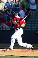 Ryan Cordell (13)  of the Hickory Crawdads follows through on his swing against the Charleston RiverDogs at L.P. Frans Stadium on May 24, 2014 in Hickory, North Carolina.  The Crawdads defeated the RiverDogs 7-3.  (Brian Westerholt/Four Seam Images)