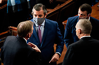 United States Senator Ted Cruz (Republican of Texas) talks with house members during a Joint session of Congress to certify the 2020 Electoral College results on Capitol Hill in Washington, DC on January 6, 2020. <br /> Credit: Erin Schaff / Pool via CNP/AdMedia