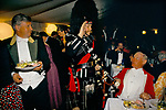 Hunt Ball at Bagborough House, Scottish Piper salutes Philip Brooke-Popham MFH Master of Quantock Staghounds 1990s Uk. Quantock Hills Somerset. 1997