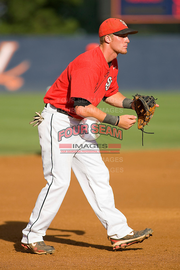 Third baseman Greg Hopkins #11 of the St. John's Red Storm on defense against the Virginia Cavaliers at the Charlottesville Regional of the 2010 College World Series at Davenport Field on June 6, 2010, in Charlottesville, Virginia.  The Red Storm defeated the Cavaliers 6-5.   Photo by Brian Westerholt / Four Seam Images