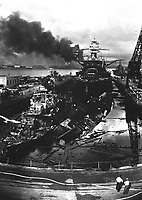 Japanese attack on Pearl Harbor.  Wrecked USS DOWNES at left and USS CASSIN at right.  In the rear is the USS PENNSYLVANIA, 33,100-ton Flagship of the Pacific Fleet, which suffered only light damage.  December 1941.  Attributed to CPhoM.H.S. Fawcett.  (Navy)<br /> Exact Date Shot Unknown<br /> NARA FILE #:  080-G-19943<br /> WAR & CONFLICT BOOK #:  1138