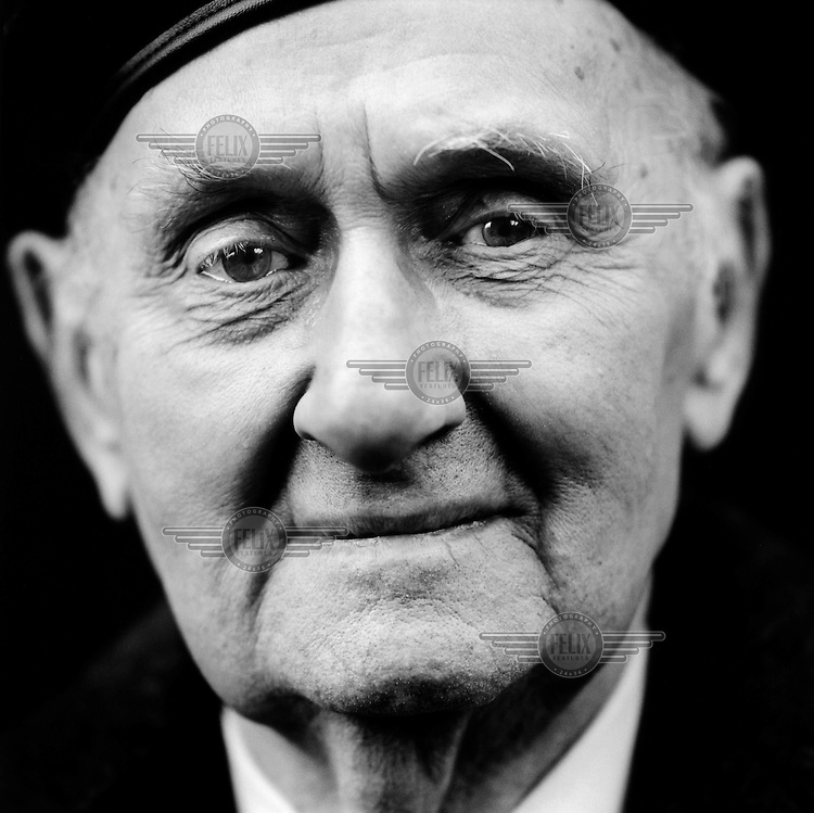 """Tadeusz Wenda (born 1923), a Polish veteran of World War II (WW2)..""""At the German farm where I was sent to work, there was another Pole who promised to take me back to Poland if I escaped with him.  We fled to the South of France and were then supposed to go by boat to Poland.  On the boat, we heard that we were not going home but to England.  In England, I joined the Polish Armoured Division.  After the invasion in France, I was on guard duty at night.  A German patrol came past and I threw a grenade at them.  One German was killed and two were wounded.  One of the wounded men was dying.  He gave me his wife's address and asked me if I would write to her.  I didn't know what to do with it. Eventually I gave the address to the chaplain and he promised that he would write to her."""".""""Later we were searching a wood that had been bombed by our planes. We came across a German officer who had lost his legs. He tried to shoot at us, so we took his weapon from him. Then he asked us to kill him. We didn't, we carried on and left him there. That still bothers me."""" CHECK with MRM/FNA"""