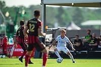 LAKE BUENA VISTA, FL - JULY 16: Frankie Amaya #24 of FC Cincinnati dribbles the ball during a game between FC Cincinnati and Atlanta United FC at Wide World of Sports on July 16, 2020 in Lake Buena Vista, Florida.