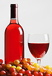 Wine Bottle and Glass, rose, red, white zinfandel, pink, grapes.