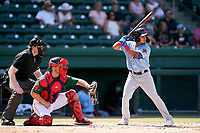Third baseman Derwin Barreto (2) of the Hickory Crawdads in a game against the Greenville Drive on Sunday, August 29, 2021, at Fluor Field at the West End in Greenville, South Carolina. The catcher is Stephen Scott (23) and the umpire is Mitch Leikam. (Tom Priddy/Four Seam Images)