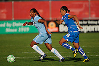 Rosana (11) of Sky Blue FC is chased by Angela Hucles (16) of the Boston Breakers. Sky Blue FC defeated the Boston Breakers 2-1 during a Women's Professional Soccer match at Yurcak Field in Piscataway, NJ, on May 31, 2009.