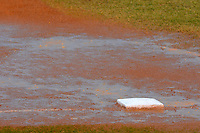 Third base covered in water during a game between the Bradley Braves and Dartmouth Big Green at Henley Field on March 22, 2013 in Lakeland, Florida.  Dartmouth defeated Bradley 7-4 the following day after rain delay.  (Mike Janes/Four Seam Images)