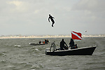 Pictured: John Bream about to land in the water after jumping from the aircraft.<br /> <br /> A daredevil former paratrooper today set a world record after he jumped 131ft into the sea from a helicopter without a parachute. John Bream, who is nicknamed 'John the Flying Fish', plummeted into the sea feet-first at 75mph as part of his daring stunt. <br /> <br /> The 34 year old, who fell for around four seconds before hitting the water, has set two records as a result of his dive, which he took on to raise awareness for veteran suicide. Mr Bream set a world record for the highest freefall into water from an aircraft and the record for jumping into British waters following today's leap into the Solent off Hayling Island, Hants. SEE OUR COPY FOR MORE DETAILS<br /> <br /> © Ewan Galvin/Solent News & Photo Agency<br /> UK +44 (0) 2380 458800