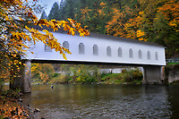 Goodpasrture Bridge with fall color. and fly fisherman Oregon
