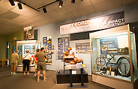 Henry Ford home and museum in Ft Myers Florida automobile inventions room with tourists at Edison & Ford Winter Estates