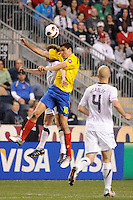 Giovanni Moreno (10) of Colombia (COL) and Jonathan Spector (2) of the United States (USA) go up for a header. The men's national teams of the United States (USA) and Colombia (COL) played to a 0-0 tie during an international friendly at PPL Park in Chester, PA, on October 12, 2010.