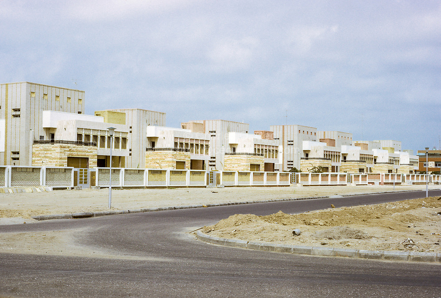 Kuwait March 1972.  Seven Brothers Construct Identical Houses on a Street in Kuwait.