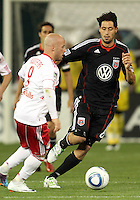 Branko Boskovic (8) of D.C. United moves in on Luke Roberts (9) of the New York Red Bulls during an MLS match at RFK Stadium, in Washington D.C. on April 21 2011. Red Bulls won 4-0.