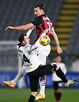 Ardian Ismajli of Spezia Calcio and Zlatan Ibrahimovic of AC Milan compete for the ball during the Serie A football match between Spezia Calcio and AC Milan at Spezia stadium in Spezia (Italy), February 13th, 2021. Photo Image Sport / Insidefoto