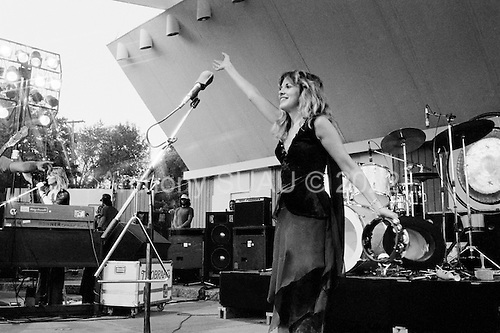 """Peoria, Illinois<br /> USA<br /> June 26, 1976<br /> <br /> Fleetwood Mac performs at an outdoor concert shortly after the album """"Fleetwood Mac"""" is released.<br /> <br /> The group members comprised of new members Stevie Nicks, and Lindsey Buckingham alongside keyboardist and vocalist Christine McVie, John McVie, bass and drummer Mic Fleetwood."""