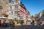 Germany; Bavaria; Lower Franconia; Ochsenfurt: main street with cafés and half-timbered houses | Deutschland, Bayern, Unterfranken, Ochsenfurt: Hauptstrasse mit Cafés und Fachwerkhaeuser in der gut erhaltenen Altstadt
