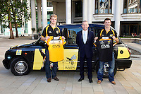 Photo: Richard Lane/Richard Lane Photography. London Wasps reception at the Central London offices of the Club's Official Main Sponsor, CVS, the business rates specialist. 02/09/2013. Wasps players, Joe Launchbury (lt) and Chris Bell (rt) with CVS Chief Executive and London Wasps Chairman, Mark Rigby.