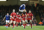 Wales pair George North and Taulupe Faletau wait to pounce on French full back Brice Dulin as he leaps to take the high ball.<br /> RBS 6 Nations 2014<br /> Wales v France<br /> Millennium Stadium<br /> 21.02.14<br /> <br /> ©Steve Pope-SPORTINGWALES