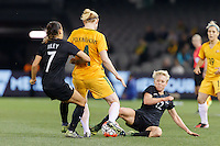 June 7, 2016: CLARE POLKINGHORNE (4) of Australia and BETSY HASSETT (12) of New Zealand compete for the ball during an international friendly match between the Australian Matildas and the New Zealand Football Ferns as part of the teams' preparation for the Rio Olympic Games at Etihad Stadium, Melbourne. Photo Sydney Low