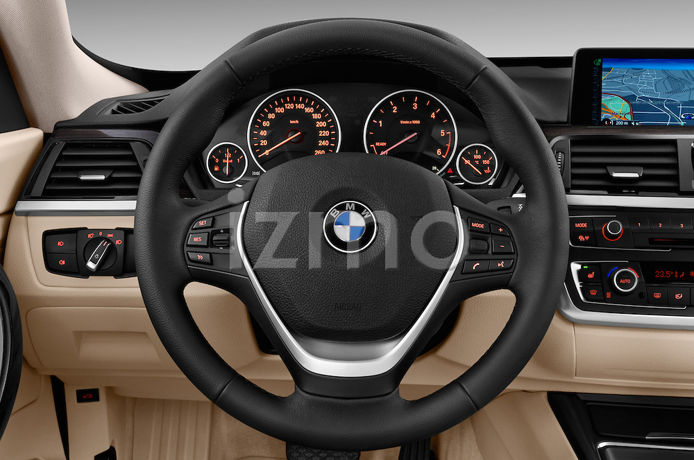 Steering wheel view of a 2013 Bmw SERIES 3 Luxury 5 Door Hatchback 2WD