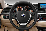 Steering wheel view of a 2013 Bmw SERIES 3 Luxury 5 Door Hatchback 2WD