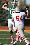 SPEARFISH, SD - OCTOBER 10, 2015 -- Ryan Hommell #16 Black Hills State throws over defender Tyler Juncker #64 of Western State Colorado during their college football game Saturday at Lyle Hare Stadium in Spearfish, S.D. (Photo by Dick Carlson/Inertia)