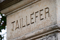 A stone pillar with the inscription Taillefer  Pomerol  Bordeaux Gironde Aquitaine France
